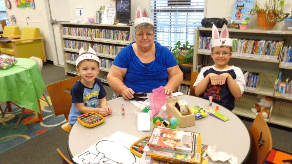 HB Children make bunny hats with Mrs. Penny