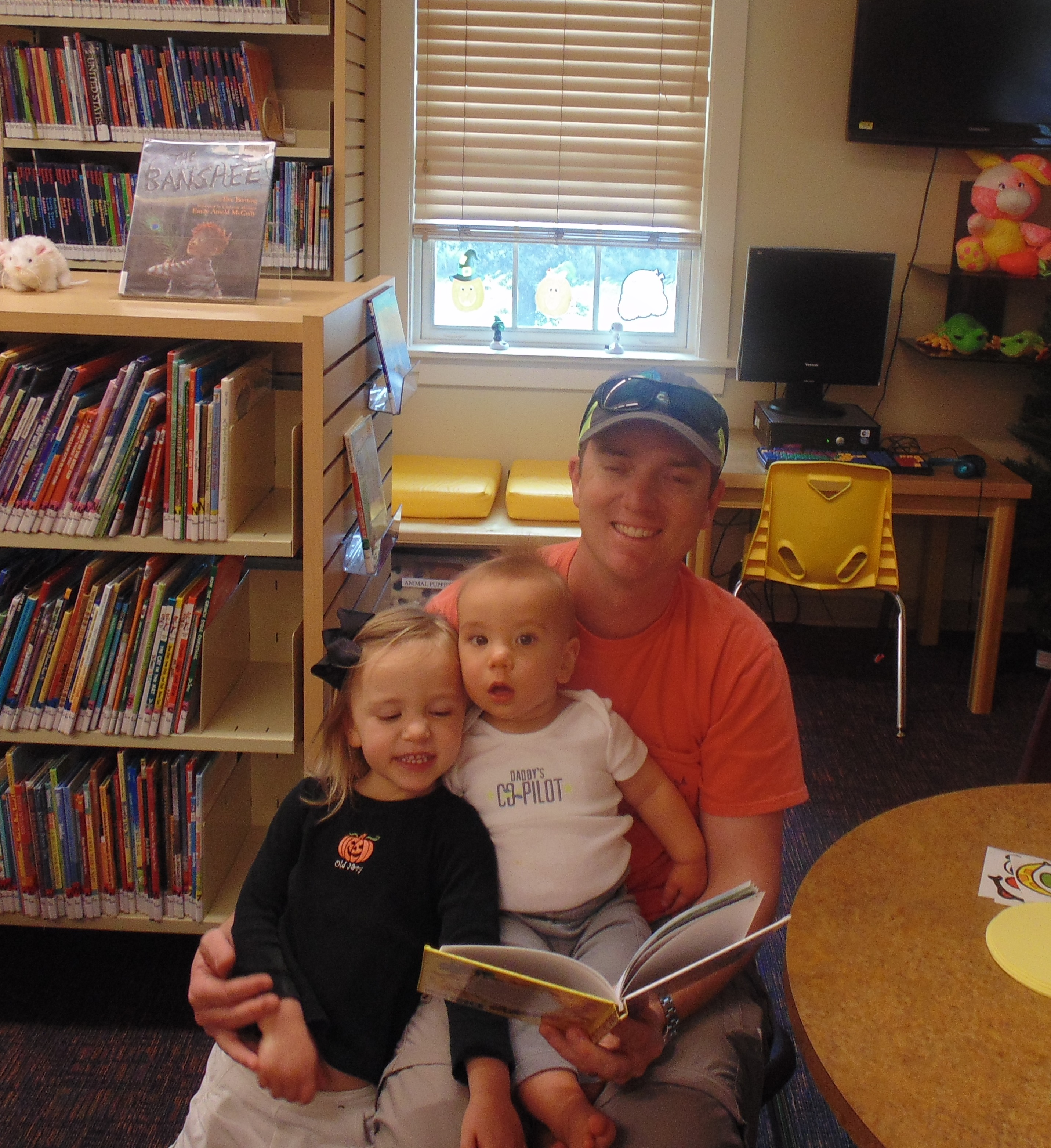 GC Father reading to children