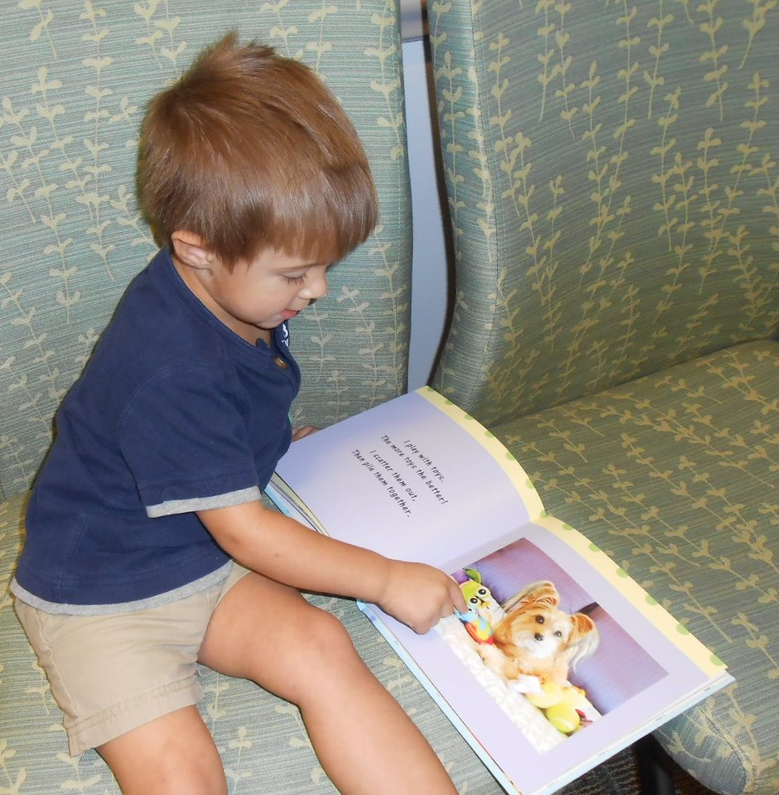 JB_Toddler reads Jeanie Book