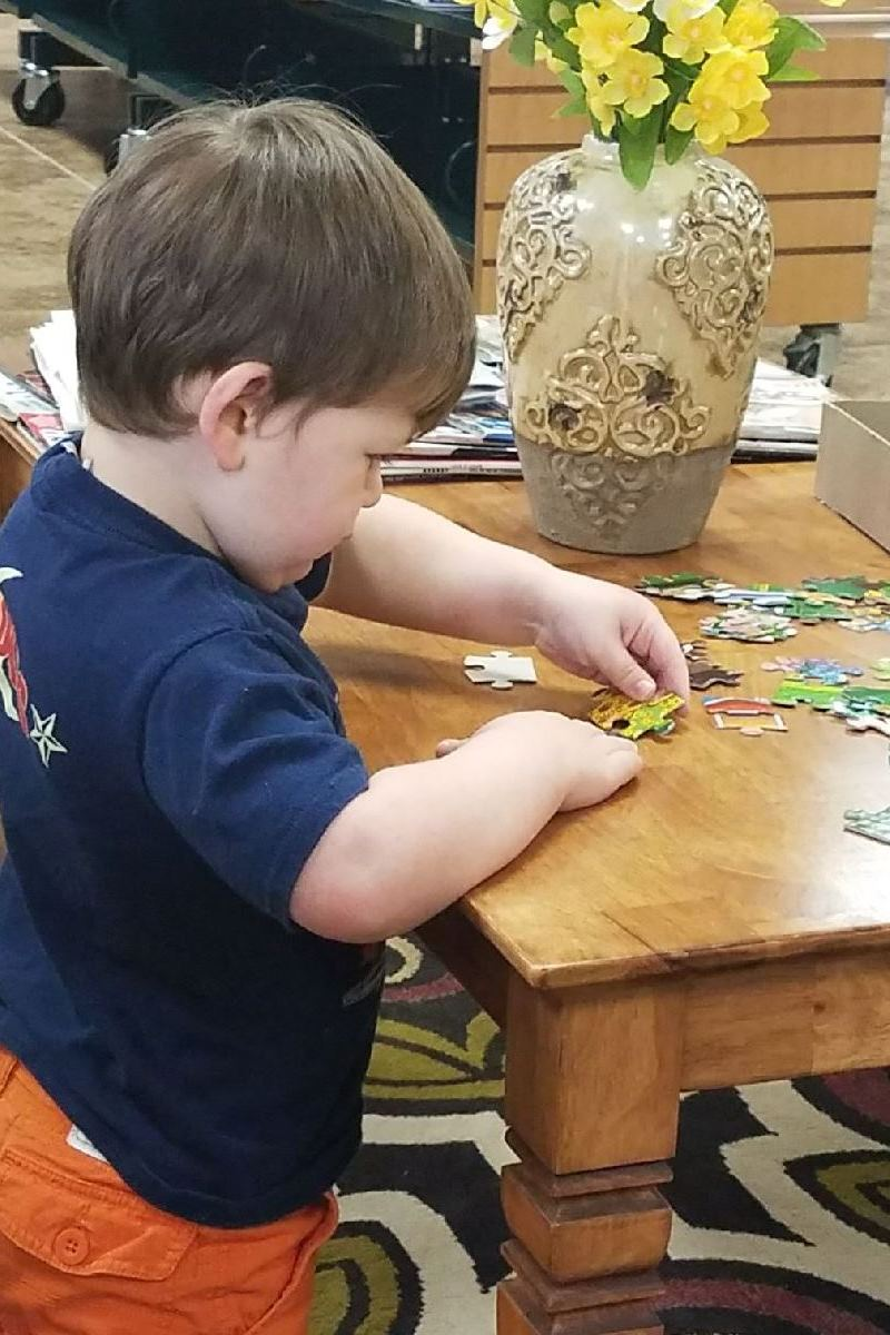 GL_ toddler putting puzzle together
