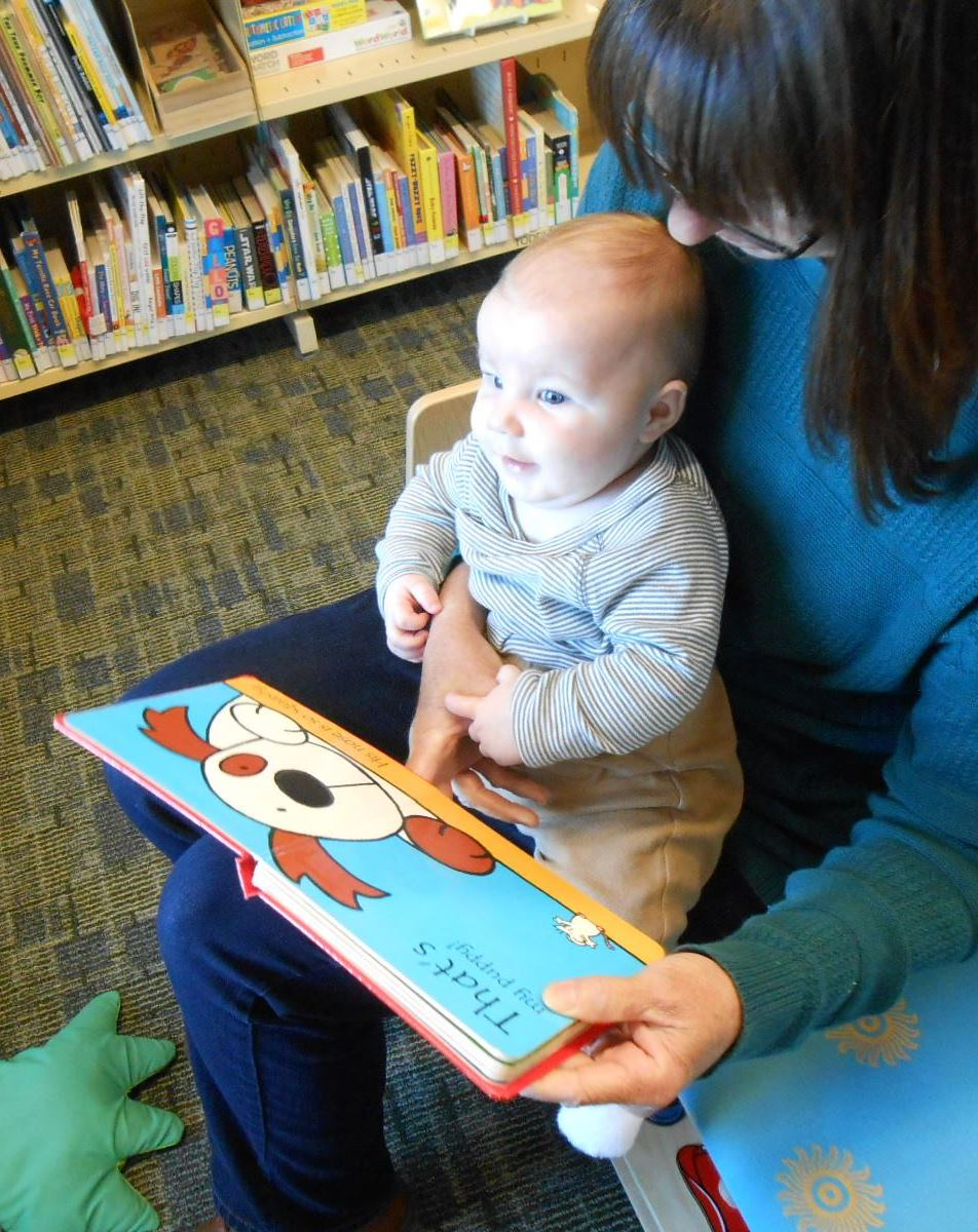toddler_Julie with book